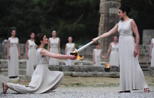 ATHENS, GREECE - MAY 10: High Priestess Ino Menegaki lights the Olympic flame at the Temple of Hera during the Lighting Ceremony of the Olympic Flame at Ancient Olympia on May 10, 2012 in Olympia, Greece. (Photo by Jamie McDonald/Getty Images)
