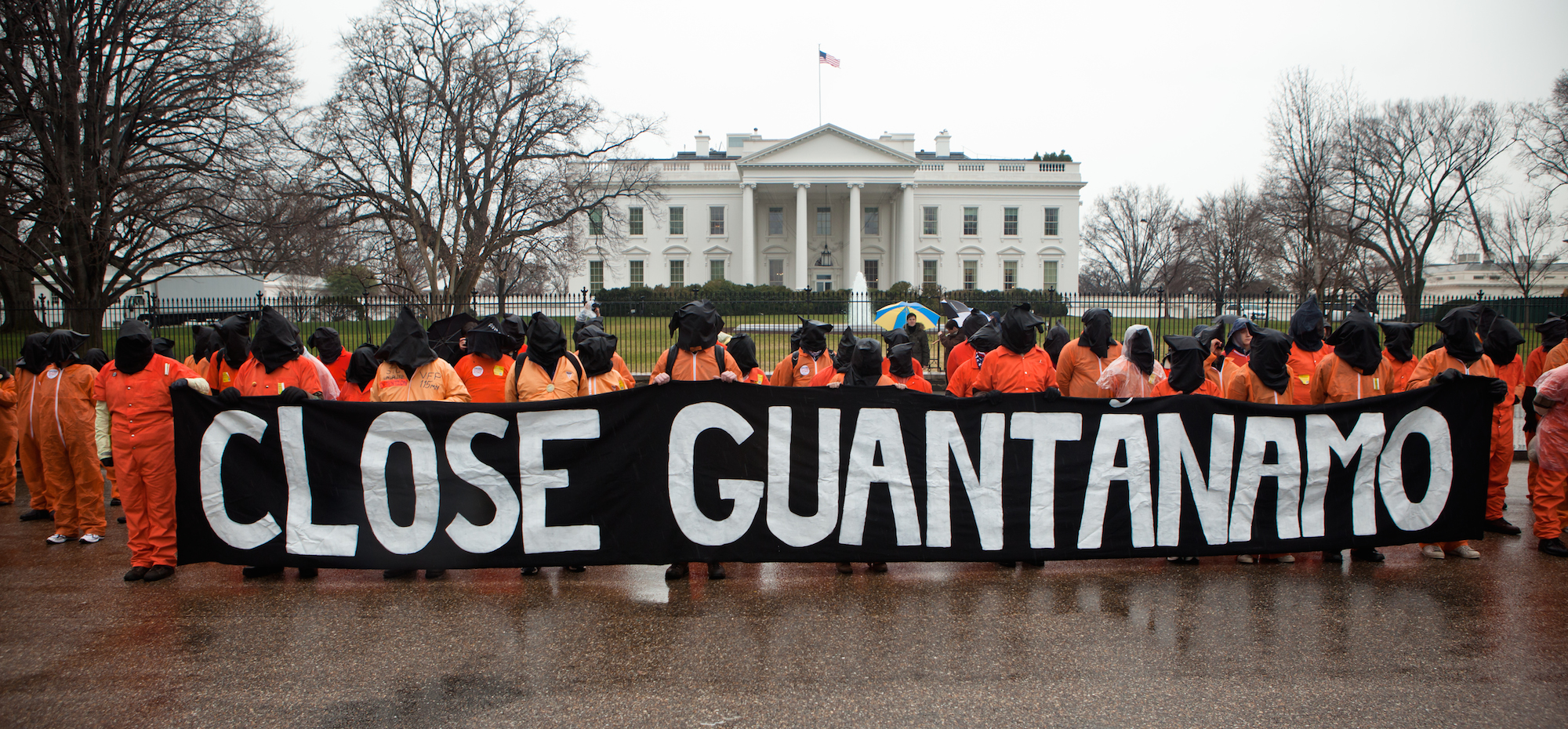 Amnesty International USA activists, holding a banner that says 'Close Guantanamo, protest the 10th anniversary of the Guantanamo Bay detention centre, in front of the White House, Washington DC, USA, 11 January 2012.